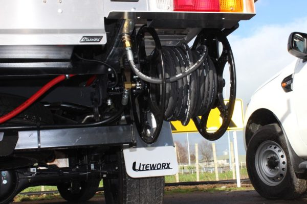 Quicklift 080 fitted to Uteworx flat deck with Gullwing toolboxes and underdeck water blaster 4
