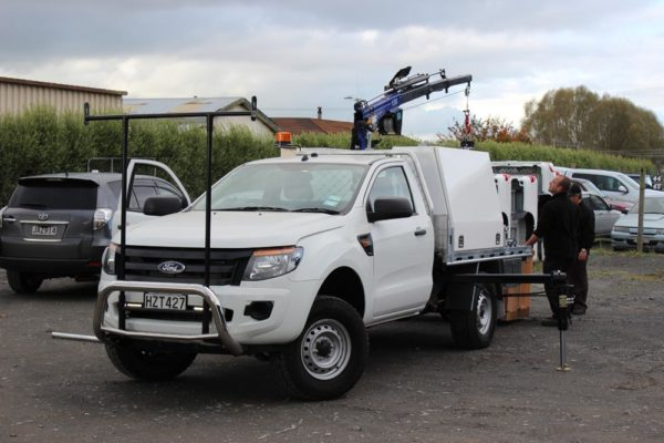 Quicklift 150 fitted to Uteworx deck with Gullwing toolboxes and pipe rack 1
