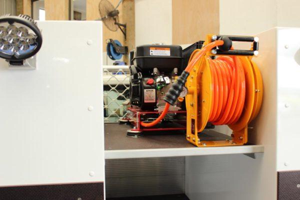 Compressor split system fitted on top of shelf between boxes - 20L oil drums go below shelf
