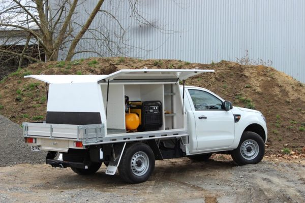 Gullwing 2 door box body fitted to Uteworx flat deck with compartment at fron of box for manuals, generator fitted to run electric compressor and welder