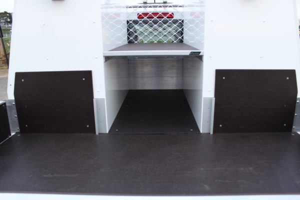 Pair of Gullwing toolboxes fitted to Uteworx flat deck with ply shelf between boxes to mount compressor on. 20L oil drums go underneath shelf 3