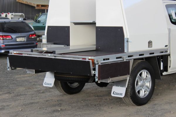 Roll-a-table fitted between pair of Gullwing boxes to slide oil drums out 2