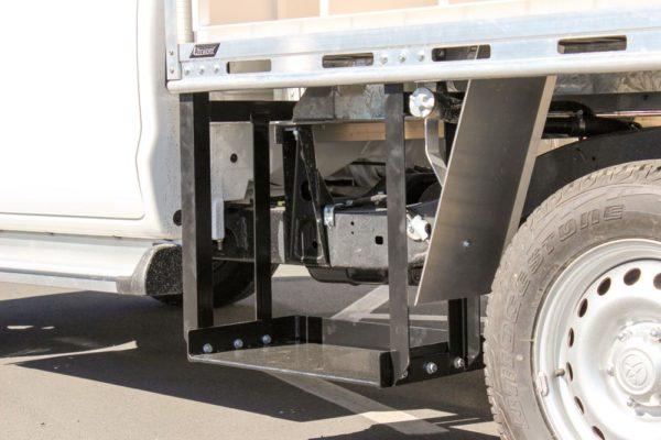 Under deck plate compactor holder 1