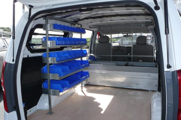 Versi 5 level shelving kit in rear of van with Rolaworx double drawer out side door of van